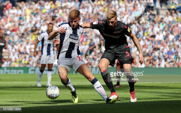 Harvey Barnes of West Bromwich Albion and Mark Beevers of Bolton Wanderers during the Sky Bet Championship match between West Bromwich Albion and...
