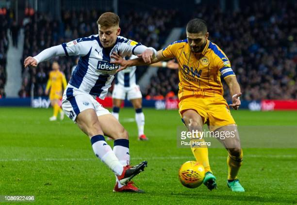 Harvey Barnes of West Bromwich Albion and Sam Morsy of Wigan Athletic at The Hawthorns on December 26 2018 in West Bromwich England