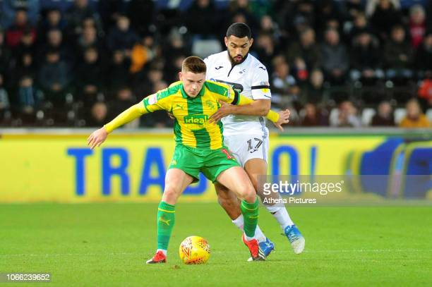 Harvey Barnes of West Bromwich Albion battles with Cameron Carter-Vickers of Swansea City during the Sky Bet Championship match between Swansea City...
