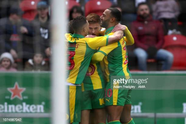 Harvey Barnes of West Bromwich Albion turns and celebrates after scoring a goal to make it 02 with Kieran Gibbs of West Bromwich Albion and Matt...