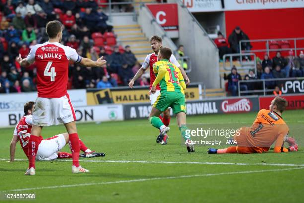 Harvey Barnes of West Bromwich Albion turns and celebrates after scoring a goal to make it 02 leaving Marek Rodak of Rotherham United grounded during...
