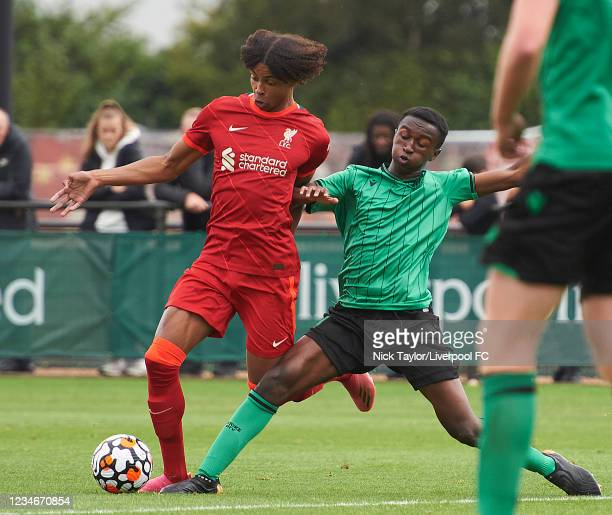 Harvey Blair of Liverpool and Matthew Lusakueno of Stoke City in action during the U18 Premier League game at AXA Training Centre on August 14, 2021...