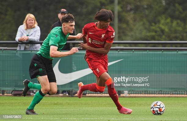 Harvey Blair of Liverpool and Sam Knowles of Stoke City in action during the U18 Premier League game at AXA Training Centre on August 14, 2021 in...