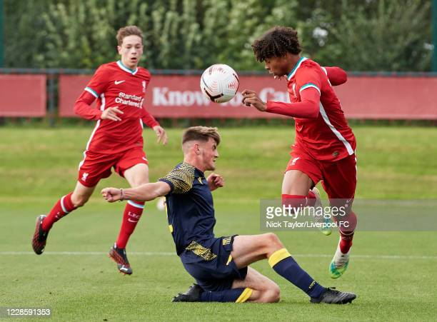 Harvey Blair of Liverpool and Tom Nixon of Stoke City in action during the U18 Premier League game at The Kirkby Academy on September 19 2020 in...