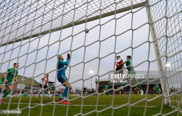 Harvey Bradbury of Woking heads the ball over the goal during the FA Cup Third Round match between Woking and Watford at Kingfield Stadium on January...