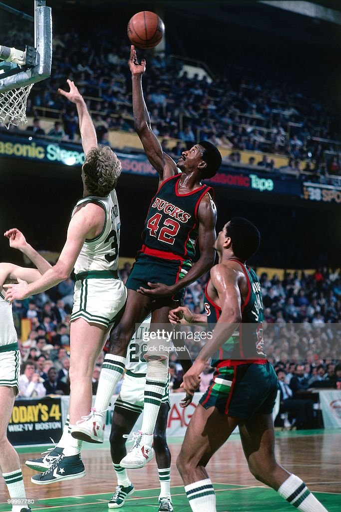 Harvey Catchings #42 of the Milwaukee Bucks shoots a layup against Larry Bird #33 of the Boston Celtics during a game played in 1983 at the Boston Garden in Boston, Massachusetts.