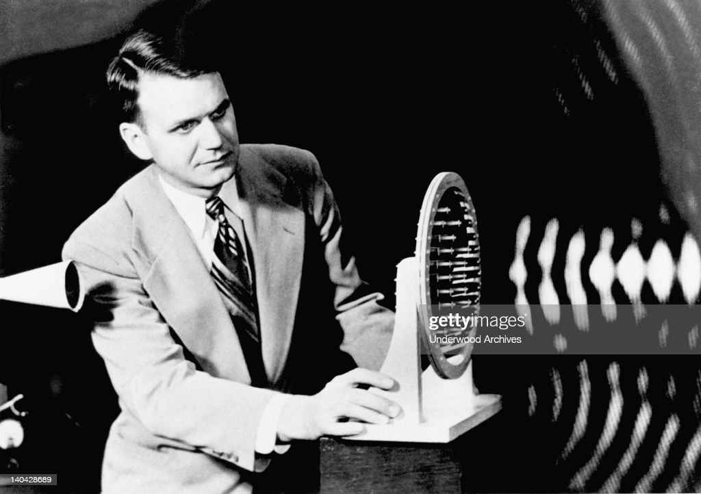 FK Harvey demonstrates the focusing of of an acoustic lens on sound waves emitted from the horn at left at Bell Telephone Laboratories, June 20, 1950.