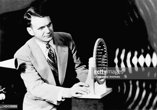 FK Harvey demonstrates the focusing of of an acoustic lens on sound waves emitted from the horn at left at Bell Telephone Laboratories June 20 1950