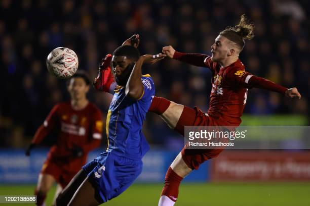 Harvey Elliot of Liverpool and RoShaun Williams of Shrewsbury Town during the FA Cup Fourth Round match between Shrewsbury Town and Liverpool at New...