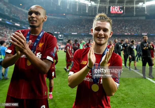Harvey Elliott and Fabinho of Liverpool at the end of the UEFA Super Cup match between Liverpool and Chelsea at Vodafone Park on August 14 2019 in...