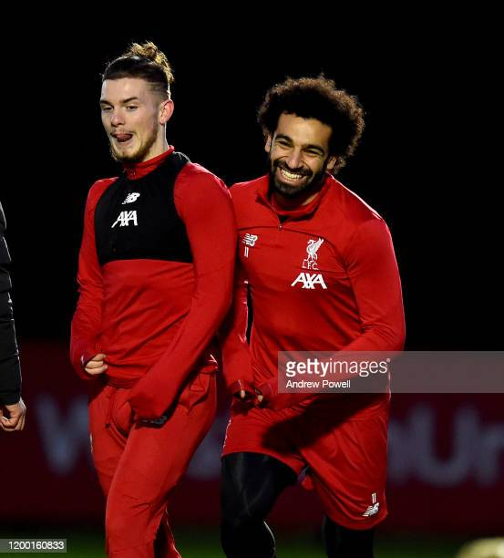 Harvey Elliott and Mohamed Salah of Liverpool during a training session at Melwood Training Ground on January 17 2020 in Liverpool England