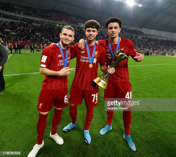 Harvey Elliott Neco Williams and Curtis Jones of Liverpool with the FIFA Club World Cup at the end of the FIFA Club World Cup final match between...