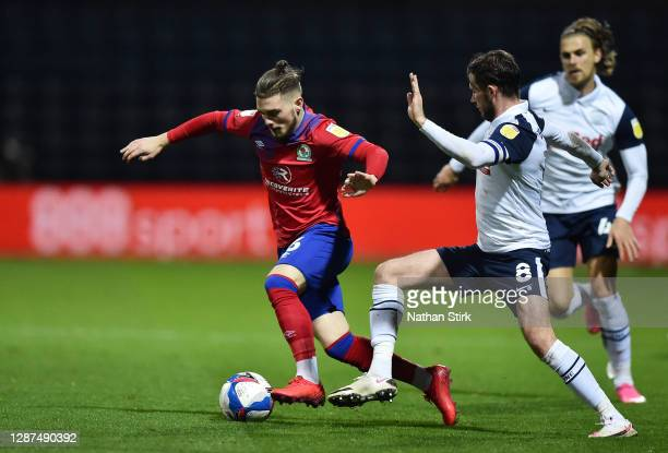 Harvey Elliott of Blackburn Rovers and Alan Browne of Preston North End battle for the ball during the Sky Bet Championship match between Preston...