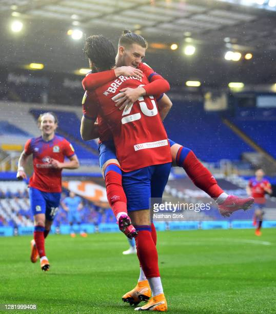 Harvey Elliott of Blackburn Rovers celebrates with Ben Brereton after he scores their third goal during the Sky Bet Championship match between...