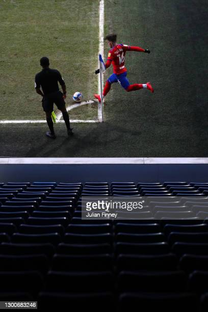 Harvey Elliott of Blackburn Rovers takes a corner kick in front of empty seats during the Sky Bet Championship match between Queens Park Rangers and...