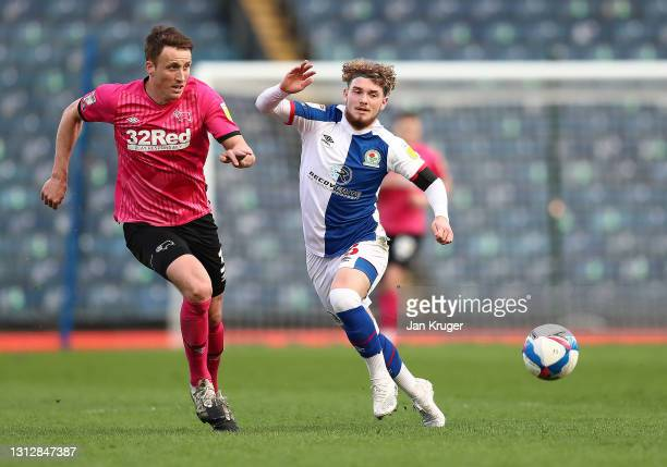 Harvey Elliott of Blackburn Rovers wins the ball from Craig Forsyth of Derby County during the Sky Bet Championship match between Blackburn Rovers...