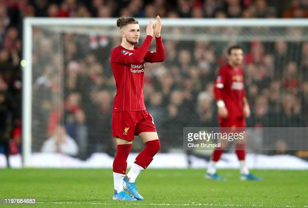 Harvey Elliott of Liverpool acknowledges the fans as he leaves the pitch during the FA Cup Third Round match between Liverpool and Everton at Anfield...