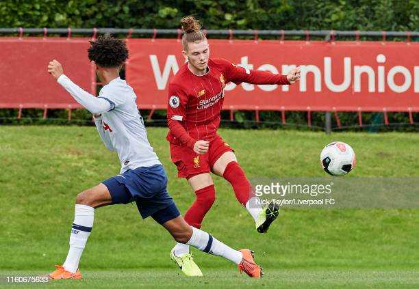 Harvey Elliott of Liverpool and Brooklyn LyonsFoster of Tottenham Hotspur in action during the PL2 game at The Kirkby Academy on August 10 2019 in...