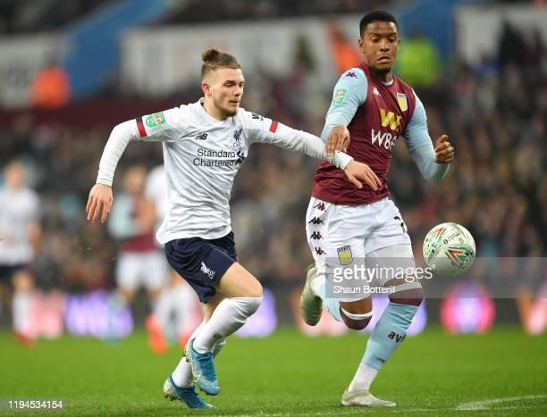 Harvey Elliott of Liverpool battles for possession with Ezri Konsa Ngoyo of Aston Villa during the Carabao Cup Quarter Final match between Aston...