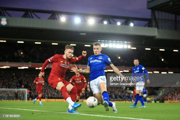 Harvey Elliott of Liverpool battles with Lucas Digne of Everton during the FA Cup Third Round match between Liverpool and Everton at Anfield on...