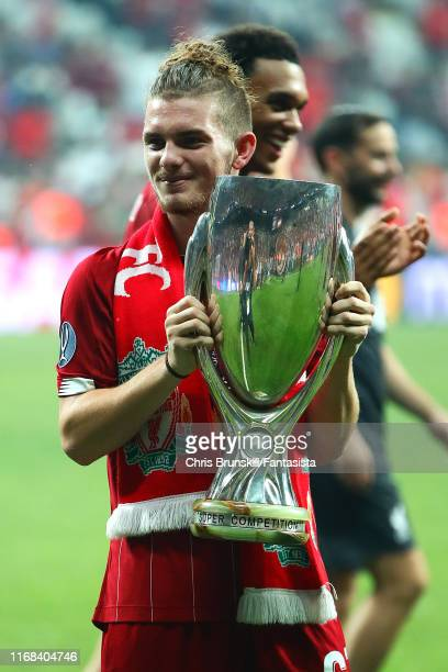 Harvey Elliott of Liverpool celebrates with the trophy following the UEFA Super Cup match between Liverpool and Chelsea at Vodafone Park on August 14...