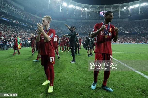 Harvey Elliott of Liverpool FC celebrates with teammate Rhian Brewster and head coach Jurgen Klopp after winning the UEFA Super Cup match between...
