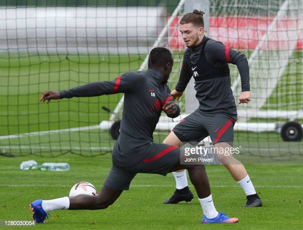 Harvey Elliott of Liverpool goes past Sadio Mane of Liverpool during a training session at Melwood Training Ground on October 13 2020 in Liverpool...