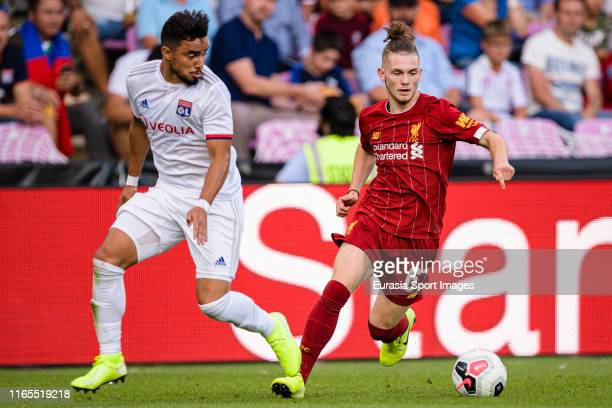 Harvey Elliott of Liverpool in action against Rafael da Silva of Olympique Lyon during the Pre-Season Friendly match between Liverpool FC and...