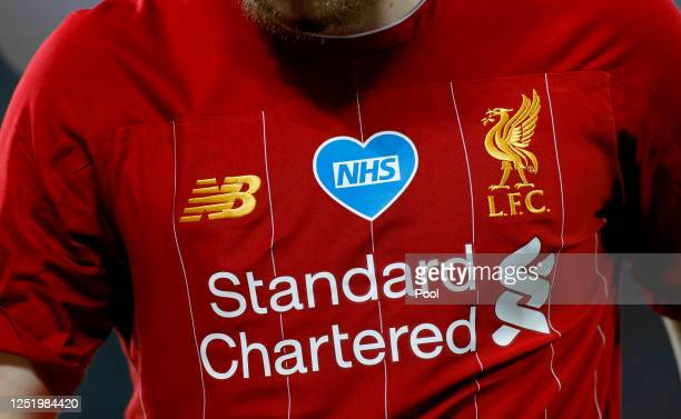 Harvey Elliott of Liverpool looks on while the NHS logo is seen on his shirt during the Premier League match between Liverpool FC and Crystal Palace...