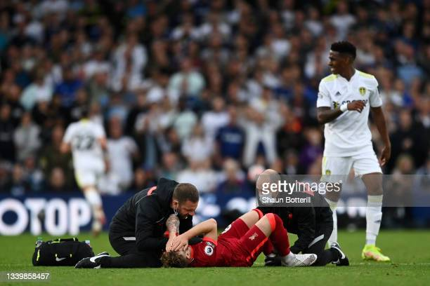 Harvey Elliott of Liverpool receives medical treatment during the Premier League match between Leeds United and Liverpool at Elland Road on September...