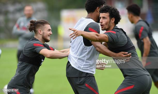 Harvey Elliott of Liverpool with Curtis Jones of Liverpool and Joe Gomez of Liverpool during a Liverpool training session on August 23, 2020 in...