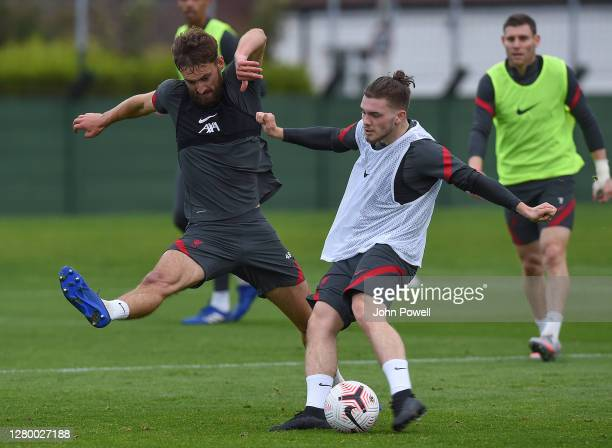 Harvey Elliott of Liverpool with Nathaniel Phillips of Liverpool during a training session at Melwood Training Ground on October 13 2020 in Liverpool...