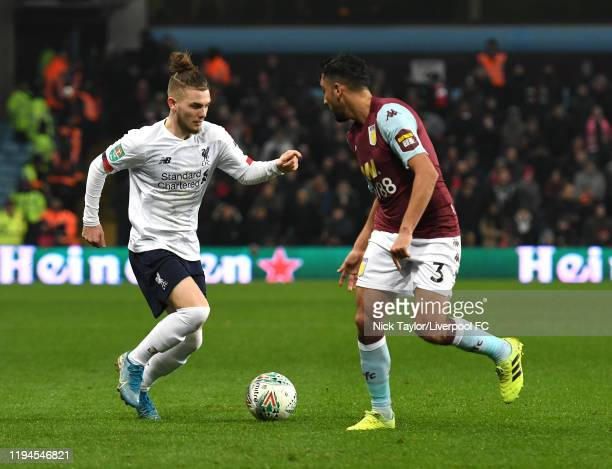 Harvey Elliott of Liverpool with Neil Taylor of Aston Villa During the Carabao Cup Quarter Final match between Aston Villa and Liverpool FC at Villa...