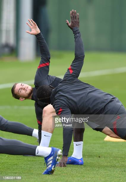 Harvey Elliott of Liverpool with Sadio Mane of Liverpool during a training session at Melwood Training Ground on October 13 2020 in Liverpool England