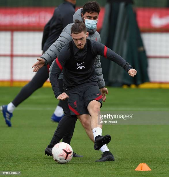 Harvey Elliott of Liverpool with Vitor Matos of Liverpool during a training session at Melwood Training Ground on October 13 2020 in Liverpool England