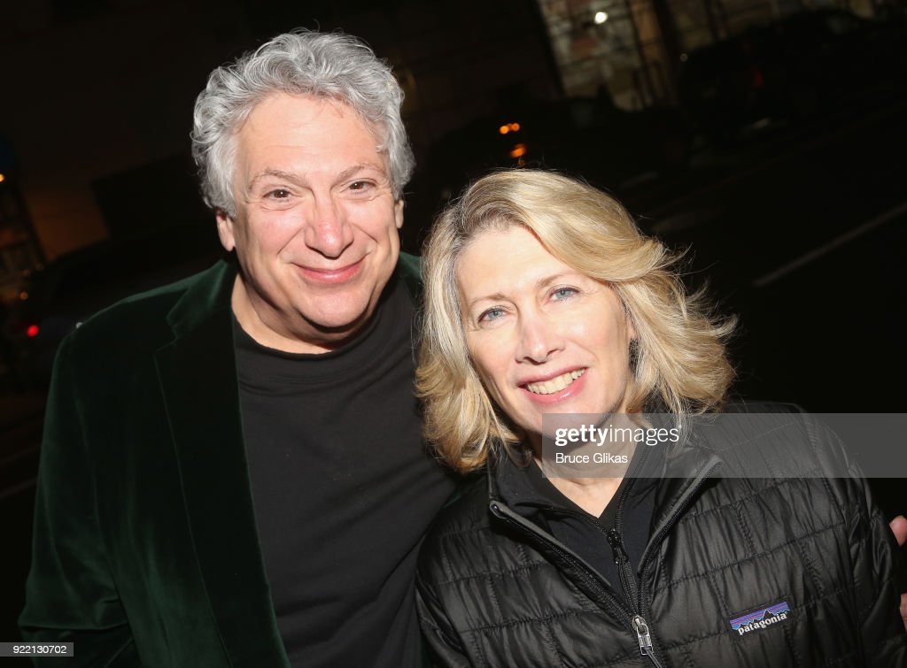 Harvey Fierstein and Second Stage Producer Carole Rothman pose as Playwright Harvey Fierstein carries 'the torch' from the Second Stage Tony Kiser Theater to the Helen Hayes Theater where it debuted 36 years ago as Harvey Fierstein's iconic play 'Torch Song' announces its broadway transfer on February 20, 2018 in New York City.