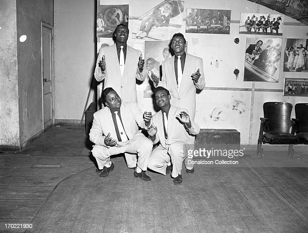 Harvey Fuqua and Prentiss Barnes and Bobby Lester and Pete Graves of the doo wop group The Moonglows pose for a portrait backstage at the Apollo...