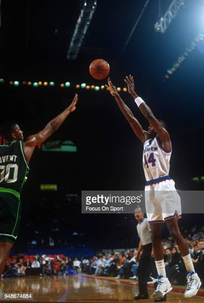 Harvey Grant of the Washington Bullets shoots over Anthony Avent of the Milwaukee Bucks during an NBA basketball game circa 1992 at the Capital...