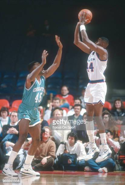 Harvey Grant of the Washington Bullets shoots over Eric Leckner of the Charlotte Hornets during an NBA basketball game circa 1991 at the Capital...