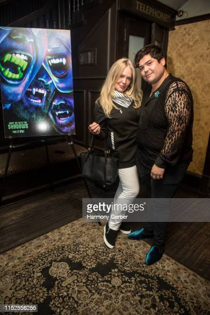 Harvey Guillen and Beverly D'Angelo attend FX's What We Do In The Shadows Season Finale Party at No Vacancy on May 29 2019 in Los Angeles California