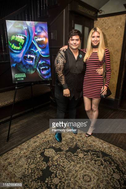 Harvey Guillen and Brittany Underwood attend FX's What We Do In The Shadows Season Finale Party at No Vacancy on May 29 2019 in Los Angeles California