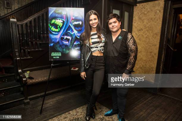 Harvey Guillen and Victoria Justice attend FX's What We Do In The Shadows Season Finale Party at No Vacancy on May 29 2019 in Los Angeles California