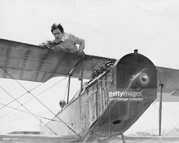 Harvey Hanford lays atop a plane's wings