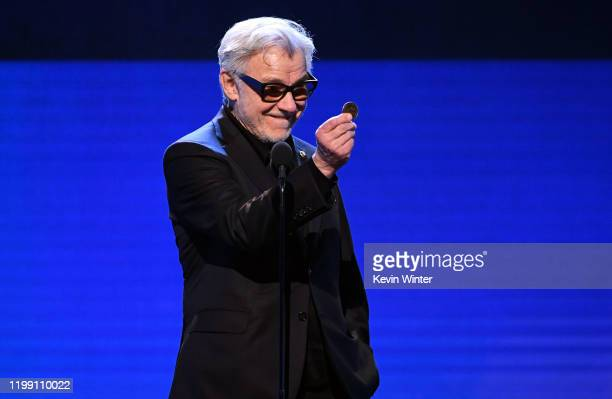 Harvey Keitel accepts the Best Acting Ensemble award for 'The Irishman' onstage during the 25th Annual Critics' Choice Awards at Barker Hangar on...