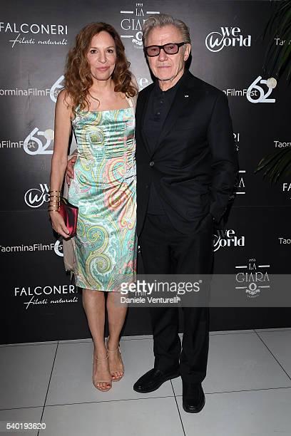 Harvey Keitel and Daphna Kastner attend 62 Taormina Film Fest Gala Dinner Day 4 on June 14 2016 in Taormina Italy