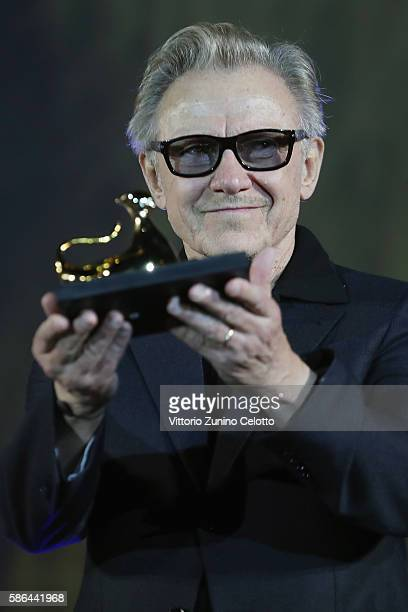 Harvey Keitel poses with the Lifetime Achievement Award during the 69th Locarno Film Festival on August 6 2016 in Locarno Switzerland