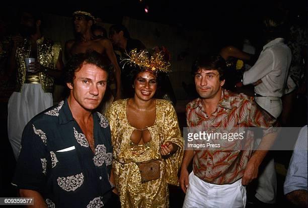 Harvey Keitel singer Fafa de Belem and Robert De Niro attends A Carnival party in Brazil circa 1981
