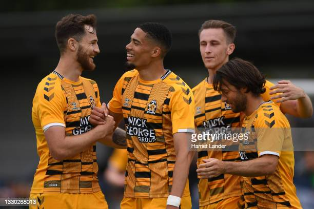 Harvey Knibbs of Cambridge United celebrates with teammate Jack Iredale after scoring his team's first goal during the pre-season friendly match...