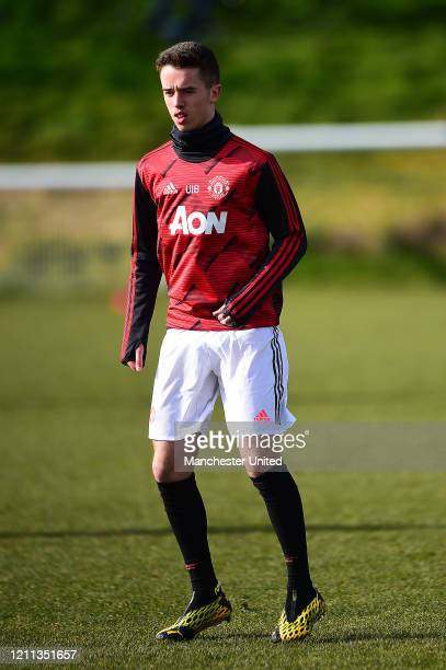 Harvey Neville of Manchester United U18s warms up ahead of the U18s Premier League match between Manchester United U18s and Sunderland U18s at The...