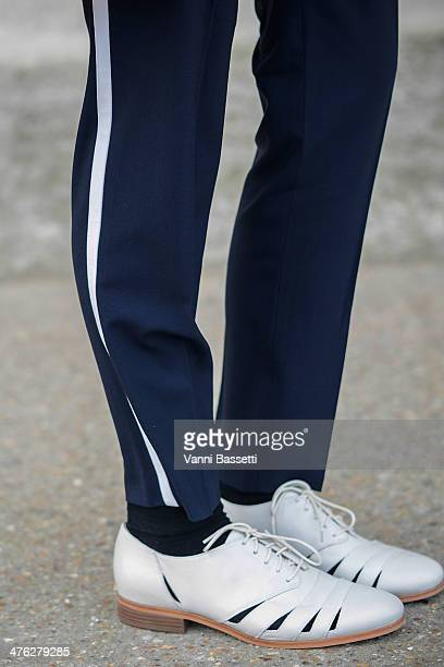 Harvey Nichols' Tina Lamb wears Vince trousers and Clark's shoes before Chloe show at the Grand Palais on March 2 2014 in Paris France